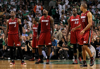 BOSTON, MA - JUNE 07:  (L-R) Dwyane Wade #3, Mario Chalmers #15, LeBron James #6, Joel Anthony #50 and Shane Battier #31 of the Miami Heat look on against the Boston Celtics in Game Six of the Eastern Conference Finals in the 2012 NBA Playoffs on June 7,