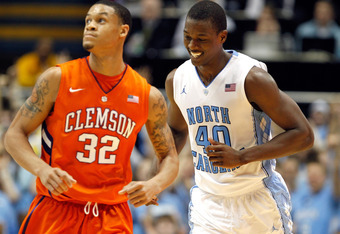 CHAPEL HILL, NC - FEBRUARY 18:  Harrison Barnes #40 of the North Carolina Tar Heels reacts to making a shot as K.J. McDaniels #32 of the Clemson Tigers checks the scoreboard during their game at the Dean Smith Center on February 18, 2012 in Chapel Hill, N