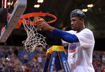 ST LOUIS, MO - MARCH 25:  Thomas Robinson #0 of the Kansas Jayhawks cuts down a piece of the net in celebration of winning 80-67 against the North Carolina Tar Heels during the 2012 NCAA Men's Basketball Midwest Regional Final at Edward Jones Dome on Marc