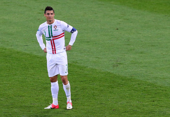 L'VIV, UKRAINE - JUNE 13:  Cristiano Ronaldo of Portugal looks on during the UEFA EURO 2012 group B match between Denmark and Portugal at Arena Lviv on June 13, 2012 in L'viv, Ukraine.  (Photo by Alex Livesey/Getty Images)