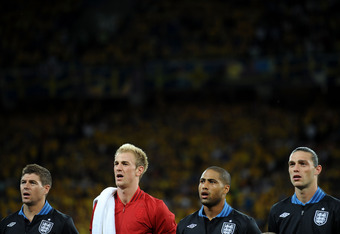 KIEV, UKRAINE - JUNE 15: (L-R) Steven Gerrard, Joe Hart, Glen Johnson Andy Carroll of England line up during the UEFA EURO 2012 group D match between Sweden and England at The Olympic Stadium on June 15, 2012 in Kiev, Ukraine.  (Photo by Christopher Lee/G