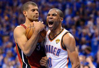 OKLAHOMA CITY, OK - JUNE 12:  (R-L) Russell Westbrook #0 of the Oklahoma City Thunder reacts alongside Shane Battier #31 of the Miami Heat in the first half in Game One of the 2012 NBA Finals at Chesapeake Energy Arena on June 12, 2012 in Oklahoma City, O