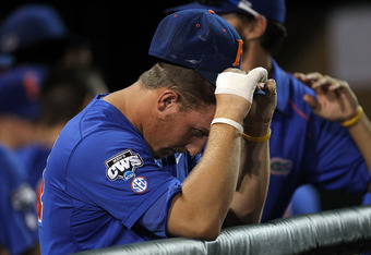OMAHA, NE - JUNE 28:  Jeff Moyer #41 of the Florida Gators reacts after losing 5-2 against the South Carolina Gamecocks during game 2 of the men's 2011 NCAA College Baseball World Series at TD Ameritrade Park Omaha on June 28, 2011 in Omaha, Nebraska.  Th