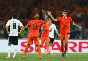 KHARKOV, UKRAINE - JUNE 13:  Robin van Persie of Netherlands celebrates scoring their first goal with Nigel de Jong of Netherlands during the UEFA EURO 2012 group B match between Netherlands and Germany at Metalist Stadium on June 13, 2012 in Kharkov, Ukr