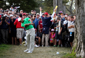 SAN FRANCISCO, CA - JUNE 16:  Tiger Woods of the United States hits a shot from the rough on the 16th hole during the third round of the 112th U.S. Open at The Olympic Club on June 16, 2012 in San Francisco, California.  (Photo by Jeff Gross/Getty Images)