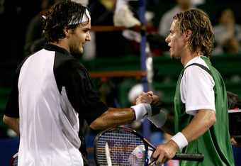 HOUSTON - NOVEMBER 21:  Roger Federer of Switzerland shakes hands with Lleyton Hewitt of Australia after the men's final of the Tennis Masters Cup November 21, 2004 at the Westside Tennis Club in Houston, Texas. Federer won the match with the score of 6-3