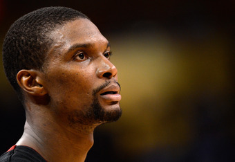 OKLAHOMA CITY, OK - JUNE 14:  Chris Bosh #1 of the Miami Heat looks on in the fourth quarter while taking on the Oklahoma City Thunder in Game Two of the 2012 NBA Finals at Chesapeake Energy Arena on June 14, 2012 in Oklahoma City, Oklahoma. NOTE TO USER: