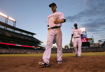 DENVER, CO - MAY 31:  Carlos Gonzalez #5 of the Colorado Rockies and Dexter Fowler #24 of the Colorado Rockies head for the dugout against the Houston Astros  in the fifth inning at Coors Field on May 31, 2012 in Denver, Colorado.  (Photo by Doug Pensinge