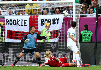 L'VIV, UKRAINE - JUNE 13:  Helder Postiga of Portugal scores the second goal during the UEFA EURO 2012 group B match between Denmark and Portugal at Arena Lviv on June 13, 2012 in L'viv, Ukraine.  (Photo by Martin Rose/Getty Images)