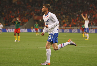 CAPE TOWN, SOUTH AFRICA - JUNE 24:  Klaas Jan Huntelaar of the Netherlands celebrates as he scores his side's second goal during the 2010 FIFA World Cup South Africa Group E match between Cameroon and Netherlands at Green Point Stadium on June 24, 2010 in