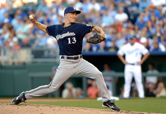 KANSAS CITY, MO - JUNE 12:  Starting pitcher Zack Greinke #13 of the Milwaukee Brewers pitches during the 1st inning of the game against the Kansas City Royals on June 12, 2012 at Kauffman Stadium in Kansas City, Missouri.  (Photo by Jamie Squire/Getty Im