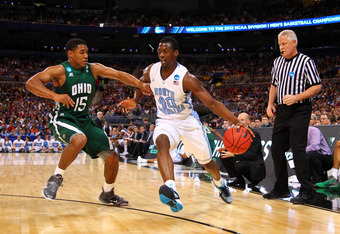 ST. LOUIS, MO - MARCH 23:  Harrison Barnes #40 of the North Carolina Tar Heels drives in the first half against Nick Kellogg #15 of the Ohio Bobcats during the 2012 NCAA Men's Basketball Midwest Regional Semifinal at Edward Jones Dome on March 23, 2012 in