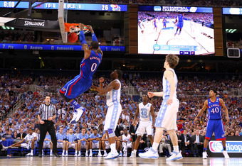 ST LOUIS, MO - MARCH 25:  Thomas Robinson #0 of the Kansas Jayhawks dunks against Reggie Bullock #35 of the North Carolina Tar Heels during the 2012 NCAA Men's Basketball Midwest Regional Final at Edward Jones Dome on March 25, 2012 in St Louis, Missouri.