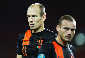 KHARKOV, UKRAINE - JUNE 17:  Arjen Robben (L) and Wesley Sneijder of Netherlands look on during the UEFA EURO 2012 group B match between Portugal and Netherlands at Metalist Stadium on June 17, 2012 in Kharkov, Ukraine.  (Photo by Julian Finney/Getty Imag