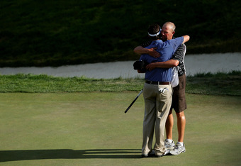 SAN FRANCISCO, CA - JUNE 16:  Amateur Beau Hossler of the United States hugs his caddie Bill Schellenberg on the 18th green during the third round of the 112th U.S. Open at The Olympic Club on June 16, 2012 in San Francisco, California.  (Photo by Andrew