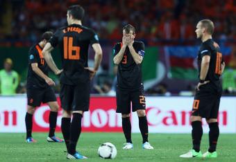 KHARKOV, UKRAINE - JUNE 17:  (L-R)  Joris Mathijsen, Robin van Persie, Rafael van der Vaart and Wesley Sneijder of Netherlands show their dejection after conceding a second goal during the UEFA EURO 2012 group B match between Portugal and Netherlands at M