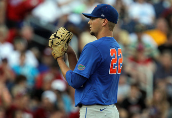 OMAHA, NE - JUNE 28:  Pitcher Karsten Whitson #22 of the Florida Gators throws against the South Carolina Gamecocks during game 2 of the men's 2011 NCAA College Baseball World Series at TD Ameritrade Park Omaha on June 28, 2011 in Omaha, Nebraska.  (Photo