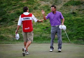 SAN FRANCISCO, CA - JUNE 16:  Graeme McDowell of Northern Ireland and his caddie Ken Comboy celebrate a birdie on the 18th hole during the third round of the 112th U.S. Open at The Olympic Club on June 16, 2012 in San Francisco, California.  (Photo by Stu