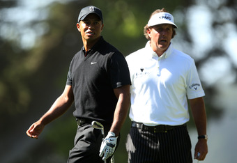 SAN FRANCISCO, CA - JUNE 15:  (L-R) Tiger Woods of the United States and Phil Mickelson of the United States look on from the 14th hole during the second round of the 112th U.S. Open at The Olympic Club on June 15, 2012 in San Francisco, California.  (Pho
