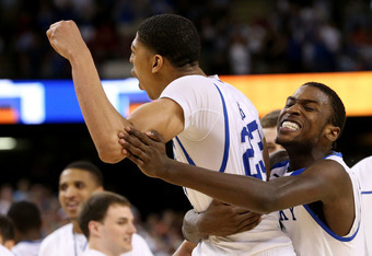 NEW ORLEANS, LA - MARCH 31:  (R) Michael Kidd-Gilchrist #14 celebrates along with teammate Anthony Davis #23 of the Kentucky Wildcats in the second half against the Louisville Cardinals during the National Semifinal game of the 2012 NCAA Division I Men's