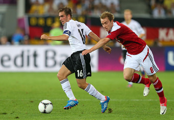 L'VIV, UKRAINE - JUNE 17:  Philipp Lahm of Germany and Christian Eriksen of Denmark compete for the ball during the UEFA EURO 2012 group B match between Denmark and Germany at Arena Lviv on June 17, 2012 in L'viv, Ukraine.  (Photo by Alex Livesey/Getty Im