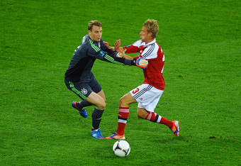 L'VIV, UKRAINE - JUNE 17:  Manuel Neuer of Germany and Tobias Mikkelsen of Denmark clash during the UEFA EURO 2012 group B match between Denmark and Germany at Arena Lviv on June 17, 2012 in L'viv, Ukraine.  (Photo by Laurence Griffiths/Getty Images)