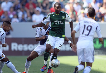 CARSON, CA - JUNE 17:  Danny Mwanga #10 of the Portland Timbers controls the ball on the attack as Sean Franklin #5, David Junior Lopes #3 and Juninho #19 of the Los Angeles Galaxy defend the play in the first half of the MLS match at The Home Depot Cente