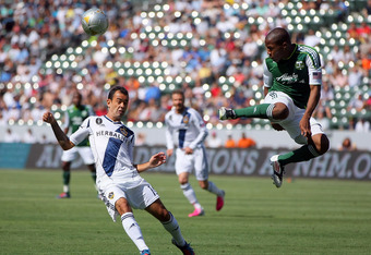 CARSON, CA - JUNE 17:  Darlington Nagbe #6 of the Portland Timbers volleys the ball over Juninho #19 of the Los Angeles Galaxy in the first half during the MLS match at The Home Depot Center on June 17, 2012 in Carson, California. The Galaxy defeated the