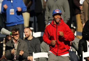 NEW YORK, NY - FEBRUARY 07:  Victor Cruz of the New York Giants walks onto the stage as the team is honored at City Hall Plaza following a ticker-tape parade in Manhattan for the second time in four years after winning the Super Bowl against the New Engla