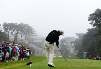 SAN FRANCISCO, CA - JUNE 17:  Graeme McDowell of Northern Ireland hits his tee shot on the 18th hole during the final round of the 112th U.S. Open at The Olympic Club on June 17, 2012 in San Francisco, California.  (Photo by Harry How/Getty Images)