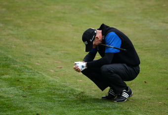 SAN FRANCISCO, CA - JUNE 17:  Jim Furyk of the United States reacts to his approach shot on the 18th hole during the final round of the 112th U.S. Open at The Olympic Club on June 17, 2012 in San Francisco, California.  (Photo by Stuart Franklin/Getty Ima