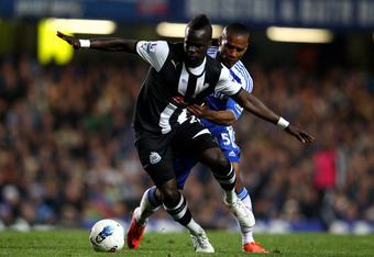 LONDON, ENGLAND - MAY 02:  Cheick Tiote of Newcastle is challenged by Florent Malouda of Chelsea during the Barclays Premier League match between Chelsea and Newcastle United at Stamford Bridge on May 2, 2012 in London, England.  (Photo by Julian Finney/G