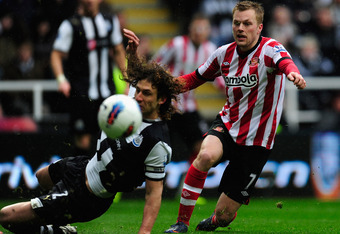 NEWCASTLE UPON TYNE, ENGLAND - MARCH 04:  Sunderland forward Sebastian Larsson gets in a shot despite the attentions of Fabricio Coloccini during the Barclays Premier League match between Newcastle United and Sunderland at St James' Park on March 4, 2012