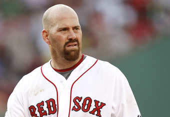 BOSTON, MA - JUNE 9:  Kevin Youkilis #20 of the Boston Red Sox looks on during their interleague game against the Washington National at Fenway Park on June 9, 2012 in Boston, Massachusetts.  (Photo by Winslow Townson/Getty Images)