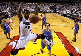MIAMI, FL - JUNE 17:  Udonis Haslem #40 of the Miami Heat dunks in the second half against Nick Collison #4 of the Oklahoma City Thunder in Game Three of the 2012 NBA Finals on June 17, 2012 at American Airlines Arena in Miami, Florida.  NOTE TO USER: Use