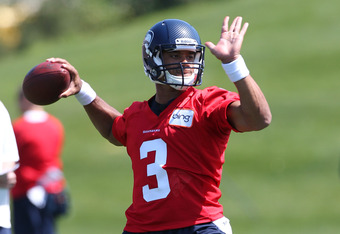 RENTON, WA - MAY 11:  Quarterback Russell Wilson #3 of the Seattle Seahawks passes during minicamp at the Virginia Mason Athletic Center on May 11, 2012 in Renton, Washington. (Photo by Otto Greule Jr/Getty Images)