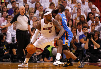 MIAMI, FL - JUNE 17:  LeBron James #6 of the Miami Heat moves the ball in the post against James Harden #13 of the Oklahoma City Thunder in Game Three of the 2012 NBA Finals on June 17, 2012 at American Airlines Arena in Miami, Florida.  NOTE TO USER: Use