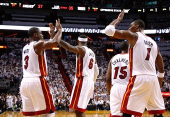 MIAMI, FL - JUNE 17:  (L-R) Dwyane Wade #3, LeBron James #6 and Chris Bosh #1 of the Miami Heat celebrate a play in the first half against the Oklahoma City Thunder in Game Three of the 2012 NBA Finals on June 17, 2012 at American Airlines Arena in Miami,