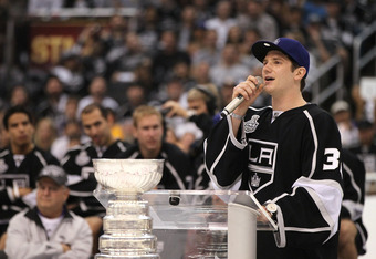 LOS ANGELES, CA - JUNE 14:  Jonathan Quick #32 of the Los Angeles Kings addresses the fans during the rally in Staples Center after the Los Angeles Kings Stanley Cup Victory Parade on June 14, 2012 in Los Angeles, California.  (Photo by Victor Decolongon/
