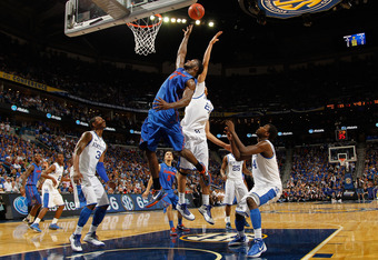 NEW ORLEANS, LA - MARCH 10:  Anthony Davis #23 of the Kentucky Wildcats blocks a shot by Patric Young #4 of the Florida Gators during the semifinals of the SEC Men's Basketball Tournament at New Orleans Arena on March 10, 2012 in New Orleans, Louisiana.