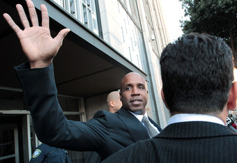 SAN FRANCISCO, CA - DECEMBER 16:  Former Major League Baseball player Barry Bonds waves as he leaves federal court following a sentencing hearing on December 16, 2011 in San Francisco, California.  Bonds was sentenced to 30 days of home confinement and tw
