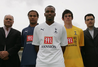LONDON - JULY 05:  New Tottenham signings Younes Kabou (2nd L), Darren Bent (C) and Gareth Bale (2nd R) with manager Martin Jol (L) and sporting director Damien Comolli at a Tottenham Hotspur photocall held at Spurs Lodge on July 5, 2007 in London, Englan
