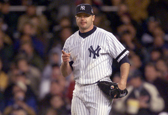 22 Oct 2000: Starting pitcher #22 Roger Clemens of the New York Yankees celebrates getting out of the fifth inning against the New York Mets during Game 2 of the MLB World Series at Yankee Stadium in the Bronx, New York. <DIGITAL IMAGE> Mandatory Credit: