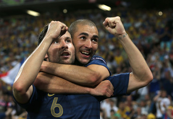 DONETSK, UKRAINE - JUNE 15:  Yohan Cabaye of France celebrates scoring their second goal with  Karim Benzema of France during the UEFA EURO 2012 group D match between Ukraine and France at Donbass Arena on June 15, 2012 in Donetsk, Ukraine.  (Photo by Ian