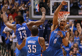 DALLAS, TX - MAY 05:  (L-R) James Harden #13, Kevin Durant #35 and Russell Westbrook #0 of the Oklahoma City Thunder celebrate after scoring with 10 seconds against the Dallas Mavericks during Game Four of the Western Conference Quarterfinals in the 2012