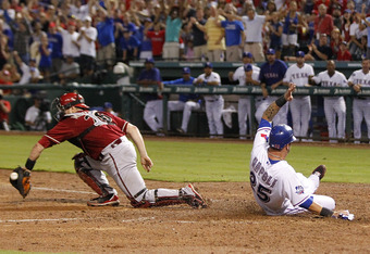 ARLINGTON, TX - JUNE 13: Mike Napoli #25 of the Texas Rangers slides into home beating the tag by Miguel Montero #26 of the Arizona Diamondbacks at Rangers Ballpark in Arlington on June 13, 2012 in Arlington, Texas. (Photo by Rick Yeatts/Getty Images)