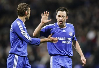 BOLTON, UNITED KINGDOM - NOVEMBER 29: John Terry of Chelsea encourages team mate Andriy Shevchenko (L) during the Barclays Premiership match between Bolton Wanderers and Chelsea at The Reebok Stadium on November 29, 2006 in Bolton, England. (Photo by Ross