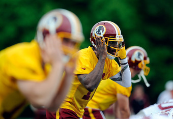 ASHBURN, VA - MAY 06:  Robert Griffin III #10 of the Washington Redskins practices during the Washington Redskins rookie minicamp on May 6, 2012 in Ashburn, Virginia.  (Photo by Patrick McDermott/Getty Images)
