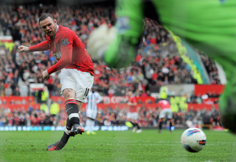 MANCHESTER, ENGLAND - MARCH 11:  Wayne Rooney of Manchester United scores his team's second goal, from a penalty kick, during the Barclays Premier League match between Manchester United and West Bromwich Albion at Old Trafford on March 11, 2012 in Manches