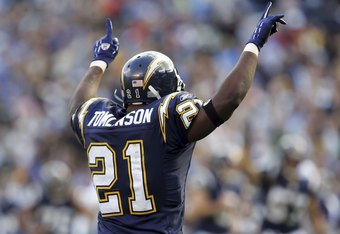 SAN DIEGO - DECEMBER 10:  LaDainian Tomlinson #21 of the San Diego Chargers celebrates after scoring a touchdown in the first half against the Denver Broncos December 10, 2006 at Qualcomm Stadium in San Diego, California. Tomlinson broke the NFL record fo